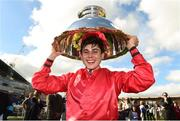 16 September 2018; Jockey Ronan Whelan celebrates with the Moyglare Stud Stakes trophy after winning The Moyglare Stud Stakes on Skitter Scatter at the Curragh Races on St Ledger Day at the Curragh Racecourse in Curragh, Kildare. Photo by Matt Browne/Sportsfile