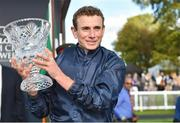 16 September 2018; Jockey Ryan Moore with the cup after winning The Comer Group International Irish St. Leger on Flag of Honour at the Curragh Races - St Ledger Day at the Curragh Racecourse in Curragh, Kildare. Photo by Matt Browne/Sportsfile