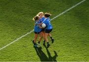 16 September 2018; Dublin players, from left, Sinéad Finnegan, Amy Connolly, and Niamh Collins celebrate after the TG4 All-Ireland Ladies Football Senior Championship Final match between Cork and Dublin at Croke Park, Dublin. Photo by Piaras Ó Mídheach/Sportsfile