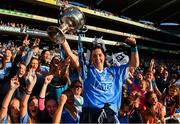 16 September 2018; Lyndsey Davey of Dublin celebrates with supporters and the Brendan Martin Cup following the TG4 All-Ireland Ladies Football Senior Championship Final match between Cork and Dublin at Croke Park, Dublin. Photo by Sam Barnes/Sportsfile