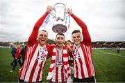 16 September 2018; Derry City players, from left, Rory Hale, Jamie McDonagh and Ronan Hale celebrate with the cup following the EA SPORTS Cup Final between Derry City and Cobh Ramblers at the Brandywell Stadium in Derry. Photo by Stephen McCarthy/Sportsfile