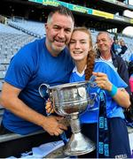 16 September 2018; Lauren Magee of Dublin celebrates with her father Johnny Magee and the Brendan Martin Cup after the TG4 All-Ireland Ladies Football Senior Championship Final match between Cork and Dublin at Croke Park, Dublin. Photo by Brendan Moran/Sportsfile