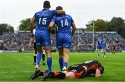 15 September 2018; Rob Kearney, left, and Jordan Larmour of Leinster celebrate a try and Josh Lewis of Dragons lies dejected during the Guinness PRO14 Round 3 match between Leinster and Dragons at the RDS Arena in Dublin. Photo by Brendan Moran/Sportsfile