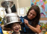17 September 2018; Noëlle Healy of Dublin and Zach Ring, age 8, from Swords in Dublin, with the Brendan Martin Cup during the TG4 All-Ireland Senior Ladies Football Champions visit to Our Lady's Children's Hospital Crumlin, in Dublin. Photo by Piaras Ó Mídheach/Sportsfile
