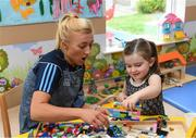 17 September 2018; Dublin footballer Carla Rowe with Anna May Shields, age 3, from Portlaoise in Laois, during the TG4 All-Ireland Senior Ladies Football Champions visit to Our Lady's Children's Hospital Crumlin, in Dublin. Photo by Piaras Ó Mídheach/Sportsfile