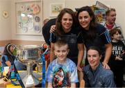 17 September 2018; Dublin footballers, from left, Noëlle Healy, Lyndsey Davey and Sinéad Aherne with Luke Byrne, age 12, from Newcastle in Dublin, during the TG4 All-Ireland Senior Ladies Football Champions visit to Our Lady's Children's Hospital Crumlin, in Dublin. Photo by Piaras Ó Mídheach/Sportsfile