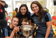 17 September 2018; Zach Ring, age 8, from Swords in Dublin, with Dublin footballers, from left, Lauren Magee, Lyndsey Davey and Noëlle Healy and the Brendan Martin Cup during the TG4 All-Ireland Senior Ladies Football Champions visit to Our Lady's Children's Hospital Crumlin, in Dublin. Photo by Piaras Ó Mídheach/Sportsfile