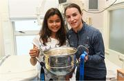 17 September 2018; Dublin captain Sinéad Aherne with Maya Kulendran, from Castlebar, Co Mayo, and the Brendan Martin Cup during the TG4 All-Ireland Senior Ladies Football Champions visit Temple Street Children's University Hospital in Dublin. Photo by Piaras Ó Mídheach/Sportsfile