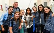 17 September 2018; Maya Kulendran, from Castlebar, Co Mayo, with the Brendan Martin Cup and Dublin manager Mick Bohan and footballers, from left, Niamh Collins, Muireann Ni Scanaill, Lauren Magee, Sinéad Aherne, Lyndsey Davey and Sinéad Goldrick during the TG4 All-Ireland Senior Ladies Football Champions visit Temple Street Children's University Hospital in Dublin. Photo by Piaras Ó Mídheach/Sportsfile