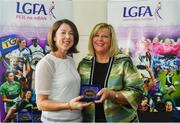 16 September 2018; 1993 Jubilee Team are honoured ahead of the TG4 All-Ireland Ladies Football Senior Championship Final match between Cork and Dublin. Pictured, LFGA President Marie Hickey makes a presentation to Patricia Murphy of Kerry at Croke Park in Dublin. Photo by Sam Barnes/Sportsfile