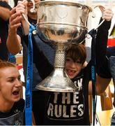 17 September 2018; Zach Ring, age 8, from Swords in Dublin, holds the Brendan Martin Cup aloft alongside Dublin footballer Lauren Magee during the TG4 All-Ireland Senior Ladies Football Champions visit to Our Lady's Children's Hospital Crumlin, in Dublin. Photo by Piaras Ó Mídheach/Sportsfile