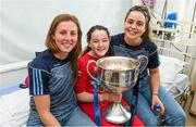 17 September 2018; Amy Coughlan, age 12, from Crumlin in Dublin, with Dublin footballers Muireann Ní Scanaill, left, and Katie Murray during the TG4 All-Ireland Senior Ladies Football Champions visit to Our Lady's Children's Hospital Crumlin, in Dublin. Photo by Piaras Ó Mídheach/Sportsfile