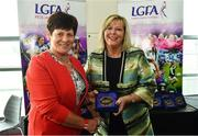 16 September 2018; 1993 Jubilee Team are honoured ahead of the TG4 All-Ireland Ladies Football Senior Championship Final match between Cork and Dublin. Pictured, LFGA President Marie Hickey, right, makes a presentation to Connie Conway of Laois at Croke Park in Dublin. Photo by Sam Barnes/Sportsfile