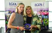 16 September 2018; 1993 Jubilee Team are honoured ahead of the TG4 All-Ireland Ladies Football Senior Championship Final match between Cork and Dublin. Pictured, LFGA President Marie Hickey, right, makes a presentation to Mary Gorman on behalf of Lulu Carroll of Laois at Croke Park in Dublin. Photo by Sam Barnes/Sportsfile