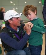 19 September 2018; Sam Watson with his son Archie, age 5, during an Irish Eventing Team welcome home at Dublin Airport in Dublin. Photo by Eóin Noonan/Sportsfile