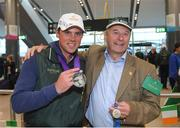 19 September 2018; Sam Watson with his father John, who won gold on Cambridge Blue at the 1978 World Games in Kentucky, during an Irish Eventing Team welcome home at Dublin Airport in Dublin. Photo by Eóin Noonan/Sportsfile