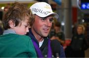 19 September 2018; Sam Watson, with his son Archie, age 5, speaking to media during an Irish Eventing Team welcome home at Dublin Airport in Dublin. Photo by Eóin Noonan/Sportsfile