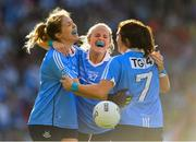 16 September 2018; Dublin players, from left, Niamh Collins, Sinéad Finnegan and Amy Connolly celebrate at the final whistle of the TG4 All-Ireland Ladies Football Senior Championship Final match between Cork and Dublin at Croke Park, Dublin. Photo by Brendan Moran/Sportsfile