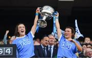 16 September 2018; Lucy Collins, left, and Leah Caffrey of Dublin lift the Brendan Martin cup following the TG4 All-Ireland Ladies Football Senior Championship Final match between Cork and Dublin at Croke Park, Dublin. Photo by David Fitzgerald/Sportsfile