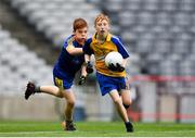 22 September 2018; Clive Conway of Owenmore Gaels, Co. Sligo in action against Jack Sumner of Clann na nGael, Co. Roscommon during the Littlewoods Ireland Connacht Provincial Days Go Games in Croke Park. This year over 6,000 boys and girls aged between six and eleven represented their clubs in a series of mini blitzes and – just like their heroes – got to play in Croke Park. For exclusive content and behind the scenes action follow Littlewoods Ireland on Facebook, Instagram, Twitter and https://blog.littlewoodsireland.ie/ Photo by Eóin Noonan/Sportsfile