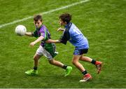 23 September 2018; Conor Deegan of Leitrim Gaels, Co Leitrim, left, in action against Padraig Heneghan of Headford, Co Galway, during the Littlewoods Ireland Connacht Provincial Days Go Games in Croke Park. This year over 6,000 boys and girls aged between six and eleven represented their clubs in a series of mini blitzes and – just like their heroes – got to play in Croke Park. For exclusive content and behind the scenes action follow Littlewoods Ireland on Facebook, Instagram, Twitter and https://blog.littlewoodsireland.ie/ Photo by Piaras Ó Mídheach/Sportsfile