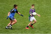 23 September 2018; Seán McKeown of Leitrim Gaels, Co Leitrim, right, in action against Matthew Cooper of Headford, Co Galway, during the Littlewoods Ireland Connacht Provincial Days Go Games in Croke Park. This year over 6,000 boys and girls aged between six and eleven represented their clubs in a series of mini blitzes and – just like their heroes – got to play in Croke Park. For exclusive content and behind the scenes action follow Littlewoods Ireland on Facebook, Instagram, Twitter and https://blog.littlewoodsireland.ie/ Photo by Piaras Ó Mídheach/Sportsfile