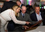 24 September 2018; Rachael Kane of Paddy Power presents Former Republic of Ireland manager Jack Charlton a framed photograph as former Republic of Ireland player David O'Leary looks on during the Goodbody Jackie's Army Squad Reunion at The K Club, Straffan, in Co. Kildare. Photo by Harry Murphy/Sportsfile