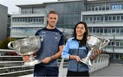 25 September 2018; Dublin Footballer Paul Mannion and Ladies footballer Lyndsey Davey, along with the Sam Maguire and Brendan Martin Cups, were at AIG Insurance's head office in Dublin today to mark Dublin's All-Ireland wins. AIG's chosen charity for 2018, Aoibheann's Pink Tie, also joined in the celebrations and were presented with a signed Dublin GAA jersey. In attendance at the AIG Cups visit are Dublin footballer Paul Mannion and Dublin ladies footballer Lyndsey Davey with the Sam Maguire and Brendan Martin Cups at AIG Offices in Dublin. Photo by Sam Barnes/Sportsfile