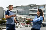 25 September 2018; Dublin Footballer Paul Mannion and Ladies footballer Lyndsey Davey, along with the Sam Maguire and Brendan Martin Cups, were at AIG Insurance's head office in Dublin today to mark Dublin's All-Ireland wins. AIG's chosen charity for 2018, Aoibheann's Pink Tie, also joined in the celebrations and were presented with a signed Dublin GAA jersey. In attendance at the AIG Cups visit are Dublin footballer Paul Mannion and Dublin ladies footballer Lyndsey Davey with the Sam Maguire Cup at AIG Offices in Dublin. Photo by Sam Barnes/Sportsfile