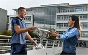 25 September 2018; Dublin Footballer Paul Mannion and Ladies footballer Lyndsey Davey, along with the Sam Maguire and Brendan Martin Cups, were at AIG Insurance's head office in Dublin today to mark Dublin's All-Ireland wins. AIG's chosen charity for 2018, Aoibheann's Pink Tie, also joined in the celebrations and were presented with a signed Dublin GAA jersey. In attendance at the AIG Cups visit are Dublin footballer Paul Mannion and Dublin ladies footballer Lyndsey Davey with the Brendan Martin Cup at AIG Offices in Dublin. Photo by Sam Barnes/Sportsfile