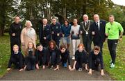 25 September 2018; Pupils of Scoil Muire Gan Smal, front row, are joined by, from left, James Nolan, Head of Paralympic Athletics, Georgina Drumm, President of Athletics Ireland, John Treacy, CEO Sport Ireland, Minister of State for Tourism and Sport Brendan Griffin T.D., Irish long distance runners Mick Clohisey of Raheny Shamrocks AC, and Catherina McKiernan, Lord Mayor of Dublin Nial Ring, CEO Athletics Ireland Hamish Adams and former Dublin Marathon winner and teacher at Scoil Muire Gan Smal sean Hehir, during the The Daily Mile Media Day at Scoil Muire Gan Smal in Inchicore, Dublin. Photo by Seb Daly/Sportsfile