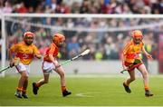 25 September 2018; Action from the half-time hurling match featuring the Éire Óg GAA club during the Liam Miller Memorial match between Manchester United Legends and Republic of Ireland & Celtic Legends at Páirc Uí Chaoimh in Cork. Photo by Stephen McCarthy/Sportsfile