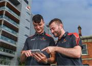 26 September 2018; PwC GAA/GPA Players of the All-Ireland Finals in football, Jack McCaffrey of Dublin, and hurler, Kyle Hayes of Limerick, were on hand to help launch the new PwC All Stars App and pick up their respective awards. Aaron Gillane was also in attendance to receive his hurling award for August. The players were joined by Uachtarán Chumann Lúthcleas Gael, John Horan, Enda Mc Donagh, Partner and Head of Assurance, PwC Ireland, and GPA National Executive Committee member, Colin Moran. The event took place at PwC on Spencer Dock in Dublin. Picured are Limerick hurler Kyles Hayes, left, and Dublin footballer Jack McCaffrey using the new PwC All Stars App. Photo by Piaras Ó Mídheach/Sportsfile