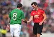 25 September 2018; Roy Keane of Manchester United Legends, right, and Andy Reid of Republic of Ireland & Celtic Legends during the Liam Miller Memorial match between Manchester United Legends and Republic of Ireland & Celtic Legends at Páirc Uí Chaoimh in Cork. Photo by David Fitzgerald/Sportsfile