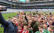 22 September 2018; The 2 Johnnies take selfies with young players during the Littlewoods Ireland Connacht Provincial Days Go Games in Croke Park. This year over 6,000 boys and girls aged between six and eleven represented their clubs in a series of mini blitzes and – just like their heroes – got to play in Croke Park. For exclusive content and behind the scenes action follow Littlewoods Ireland on Facebook, Instagram, Twitter and https://blog.littlewoodsireland.ie/ Photo by Eóin Noonan/Sportsfile