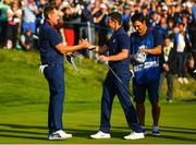 28 September 2018; Ian Poulter, left and Rory McIlroy of Europe celebrate on the 16th green following their Afternoon Foursome Match against Dustin Johnson and Rickie Fowler of USA during the Ryder Cup 2018 Matches at Le Golf National in Paris, France. Photo by Ramsey Cardy/Sportsfile