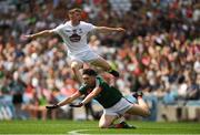 5 August 2018; Jimmy Hyland of Kildare looks on after taking a shot as despite the efforts of Cathal Horan of Mayo during the EirGrid GAA Football All-Ireland U20 Championship final match between Mayo and Kildare at Croke Park in Dublin. Photo by Piaras Ó Mídheach/Sportsfile