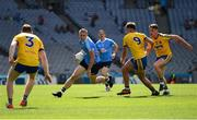 5 August 2018; Eoghan O'Gara of Dublin takes on Roscommon players, from left, Peter Domican, Enda Smith, and Niall McInerney during the GAA Football All-Ireland Senior Championship Quarter-Final Group 2 Phase 3 match between Dublin and Roscommon at Croke Park in Dublin. Photo by Piaras Ó Mídheach/Sportsfile