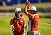 29 September 2018; Tommy Fleetwood of Europe celebrates with partner Francesco Molinari after winning their Fourball Match against Tiger Woods and Patrick Reed of USA during the Ryder Cup 2018 Matches at Le Golf National in Paris, France. Photo by Ramsey Cardy/Sportsfile