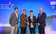 29 September 2018; Matthew Cooley of Corofin, Galway, is presented with his Football Team of the Year Award by Pat O'Doherty, ESB Chief Executive, alongside Former Tyrone footballer and Electric Ireland Minor Star Awards judge Sean Cavanagh, left, and Uachtarán Chumann Lúthcleas Gael John Horan. The Hurling and Football Team of the Year was selected by an expert panel of GAA legends including Ollie Canning, Sean Cavanagh, Michael Fennelly and Daniel Goulding. Sponsors of the GAA Minor Championships, Electric Ireland today recognised the talent and dedication of 15 Minor football players, and 15 Minor hurling players at the second annual Electric Ireland Minor Star Awards at Croke Park. #GAAThisIsMajor Photo by Sam Barnes/Sportsfile