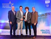 29 September 2018; Electric Ireland Minor Footballer of the Year 2018 Paul Walsh of Brosna, Kerry, second from right, is presented with his award by Former Tyrone footballer and Electric Ireland Minor Star Awards judge Sean Cavanagh, alongside Uachtarán Chumann Lúthcleas Gael John Horan, left, and Pat O'Doherty, ESB Chief Executive, at the 2018 Electric Ireland Minor Star Awards. The Football Team of the Year was selected by an expert panel of GAA legends including Ollie Canning, Sean Cavanagh, Michael Fennelly and Daniel Goulding. Sponsors of the GAA Minor Championships, Electric Ireland today recognised the talent and dedication of 15 Minor football players, and 15 Minor hurling players at the second annual Electric Ireland Minor Star Awards at Croke Park. #GAAThisIsMajor Photo by Sam Barnes/Sportsfile