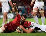 29 September 2018; Sam Arnold of Munster celebrates after scoring his side's seventh try despite the tackle of Eric O'Sullivan of Ulster during the Guinness PRO14 Round 5 match between Munster and Ulster at Thomond Park in Limerick. Photo by Matt Browne/Sportsfile