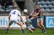 30 September 2018; Paidi White of St. Sylvesters passes to teammate Johnny Peacock under pressure from Paul Mannion of Kilmacud Crokes during the Dublin County Senior Club Football Championship Quarter-Final match between St. Sylvester's and Kilmacud Crokes at Parnell Park in Dublin. Photo by Harry Murphy/Sportsfile
