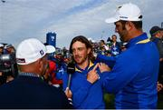 30 September 2018; Tommy Fleetwood, left, and Jon Rahm of Europe celebrate winning the Ryder Cup while being interviewed by Canal+ following the Ryder Cup 2018 Matches at Le Golf National in Paris, France. Photo by Ramsey Cardy/Sportsfile