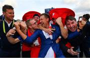 30 September 2018; Ian Poulter of Europe celebrates with supporters after winning the Ryder Cup following the Ryder Cup 2018 Matches at Le Golf National in Paris, France. Photo by Ramsey Cardy/Sportsfile
