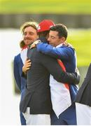 30 September 2018; Rory McIlroy of Europe hugs Tiger Woods of USA with Tommy Fleetwood to their left, after the Ryder Cup 2018 Matches at Le Golf National in Paris, France. Photo by Ramsey Cardy/Sportsfile