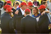 30 September 2018; Tommy Fleetwood of Europe, second from right, with members of the USA team after the Ryder Cup 2018 Matches at Le Golf National in Paris, France. Photo by Ramsey Cardy/Sportsfile