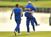 30 September 2018; Alex Norén of Europe celebrates with team mates after making a putt on the 18th green during his Singles Match against Bryson DeChambeau of USA during the Ryder Cup 2018 Matches at Le Golf National in Paris, France. Photo by Ramsey Cardy/Sportsfile