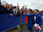 30 September 2018; Francesco Molinari, left, and Rory McIlroy of Europe celebrate with supporters after winning the Ryder Cup following the Ryder Cup 2018 Matches at Le Golf National in Paris, France. Photo by Ramsey Cardy/Sportsfile