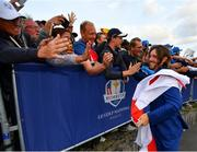 30 September 2018; Tommy Fleetwood of Europe celebrates with supporters after winning the Ryder Cup following the Ryder Cup 2018 Matches at Le Golf National in Paris, France. Photo by Ramsey Cardy/Sportsfile